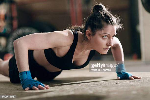 Female fighter doing pushups