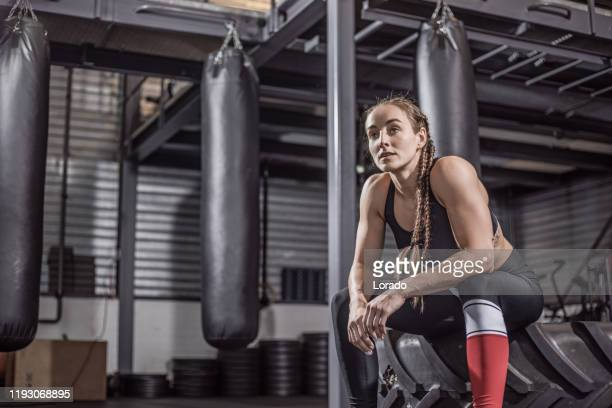 female fighter in a black gym - mixed martial arts stock pictures, royalty-free photos & images