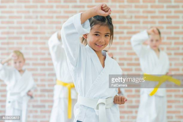 female fighter - taekwondo kids stock photos and pictures