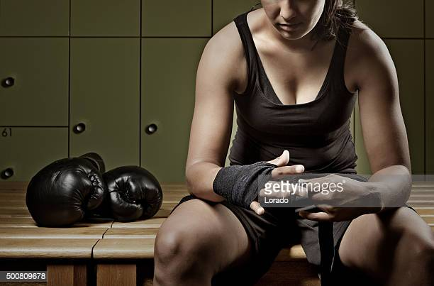 Female fighter preparing for training session