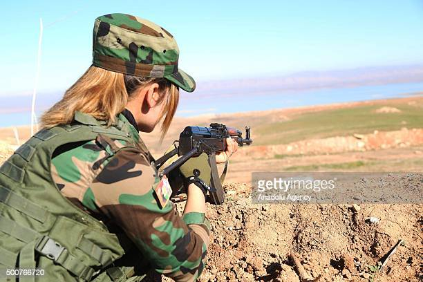 A female fighters aims her rifle as the Syrian Peshmerga fighters are being trained to fight against Daesh and Assad forces at a camp located in Old...