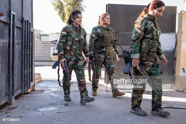 Female fighters belonging to Kurdistan Freedom Party talk as they wait to go back to the frontline at their political base in Erbil Iraq on 18...