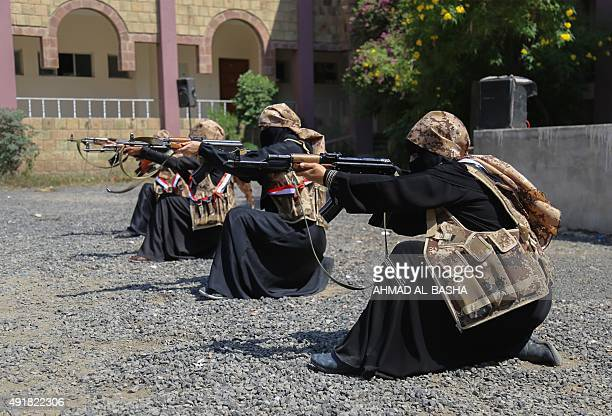 Female fighters from the Popular Resistance Committees, supporting forces loyal to Yemen's Saudi-backed President Abedrabbo Mansour Hadi, demonstrate...