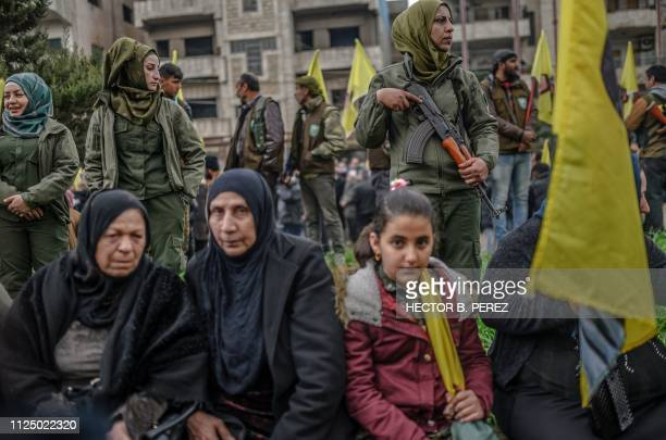 TOPSHOT Female fighters from the Syrian Democratic Forces attend demonstration in support of Kurdish militant leader Abdullah Ocalan on February 15...