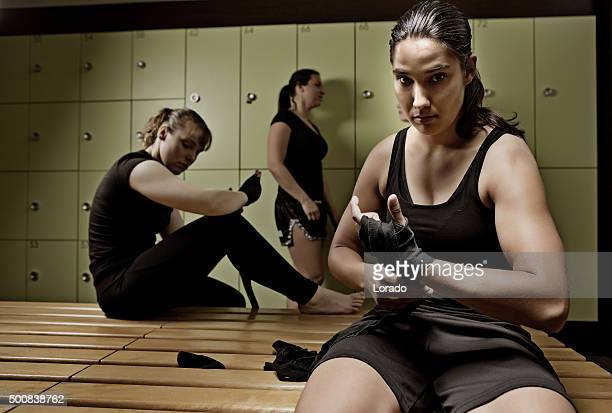 Female fighters preparing for training session