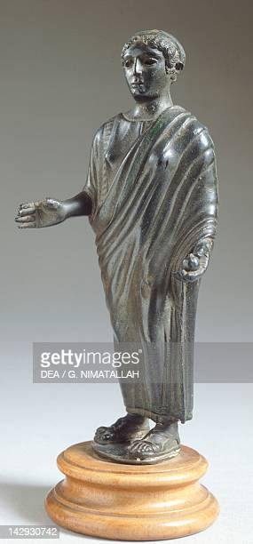 Female figure in bronze making an offering Etruscan Civilization 425420 BC Florence Museo Archeologico Nazionale