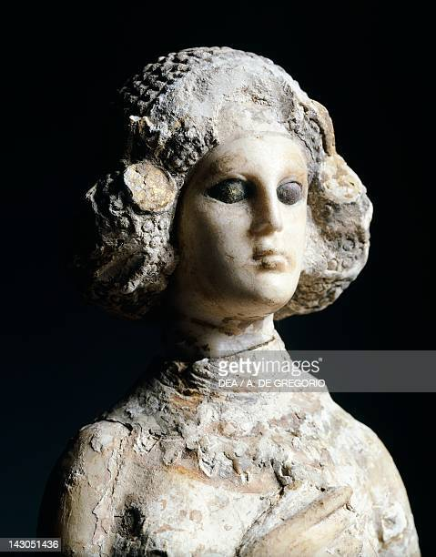 Female figure in limestone marble and stucco lateral view Artefact from Seleucia Iraq Parthian Civilization 1st2nd Century Bagdad National Iraq Museum