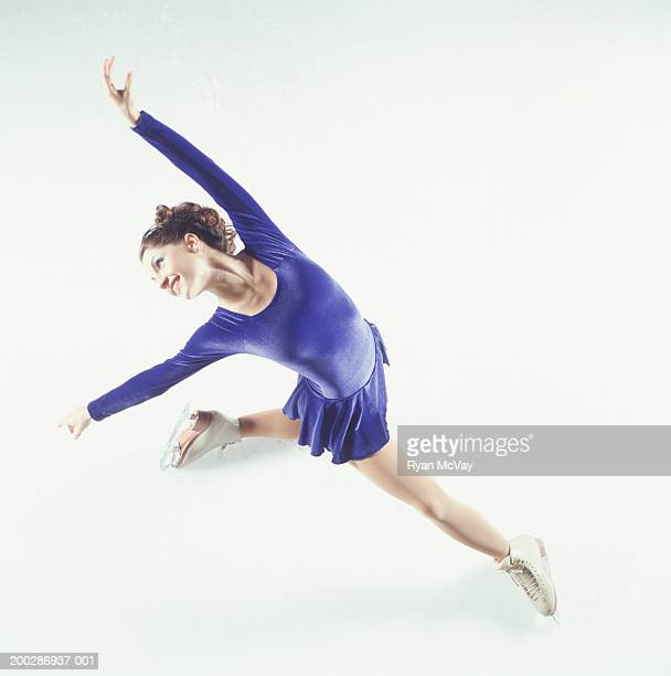 Female figure skater performing on ice