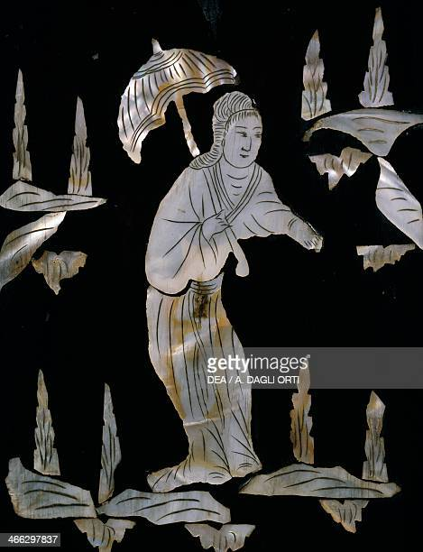 Female figure with umbrella detail from a mother of pearl inlaid cabinet with chinoiserie decoration 19th century