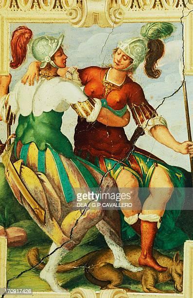 Female figures wearing helmets detail from a fresco in Manta Castle Saluzzo Piedmont Italy