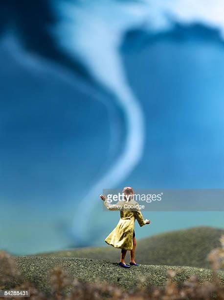 Female figurine and tornado