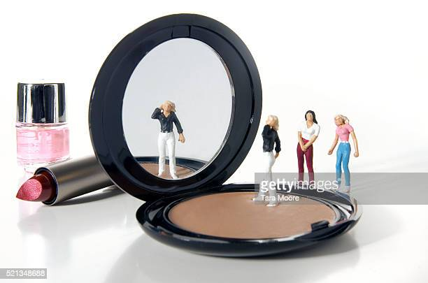 Female Figurine Looking in Mirror