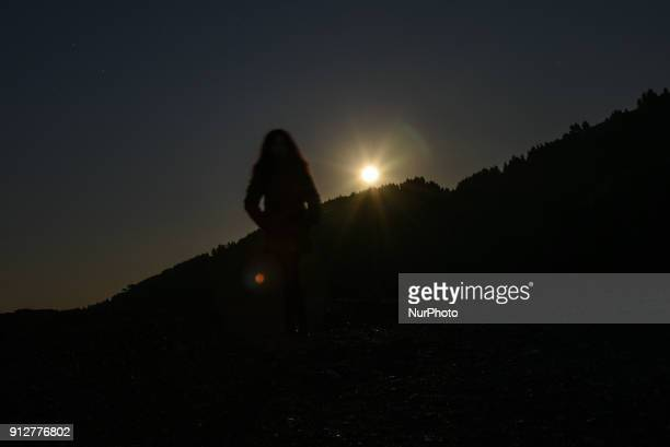 Female figuring at the second full moon of January 2018 the blue moon arising over the Aegean sea in Pilio on Euboea on January 31 2018