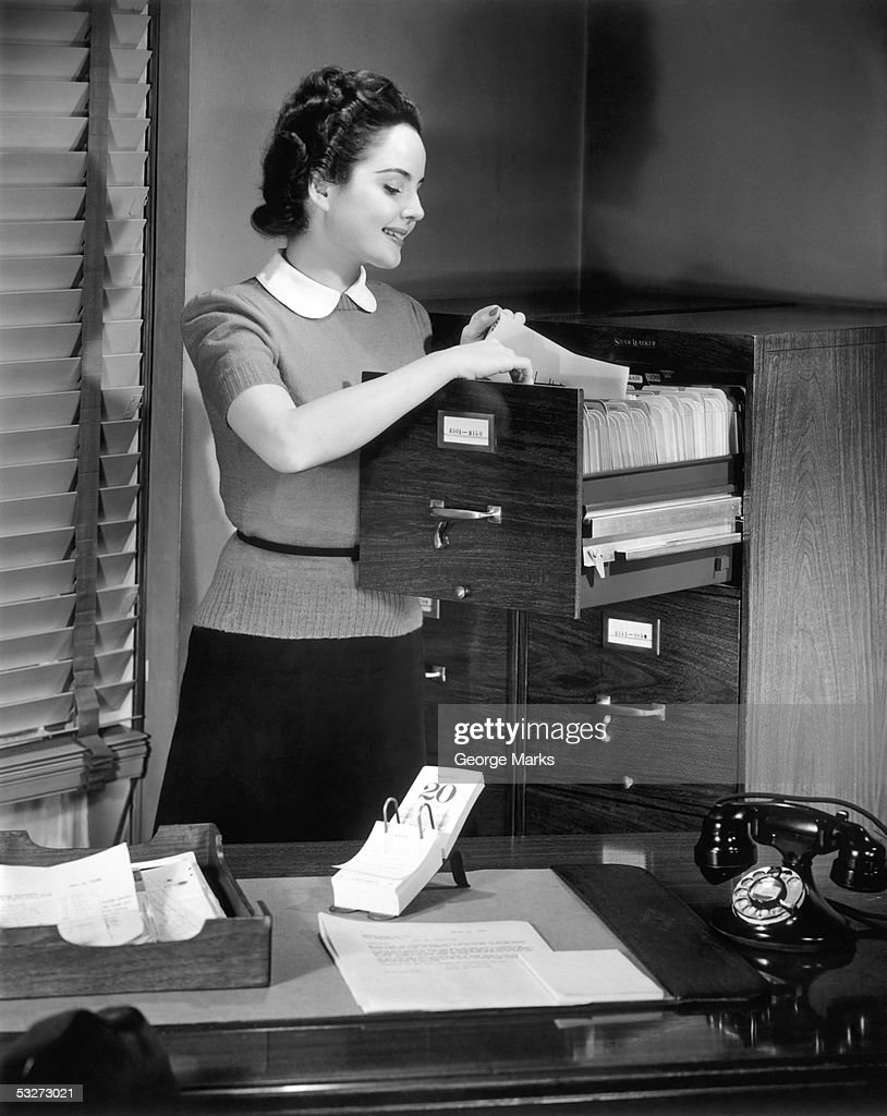Female file clerk at office files : Stock Photo