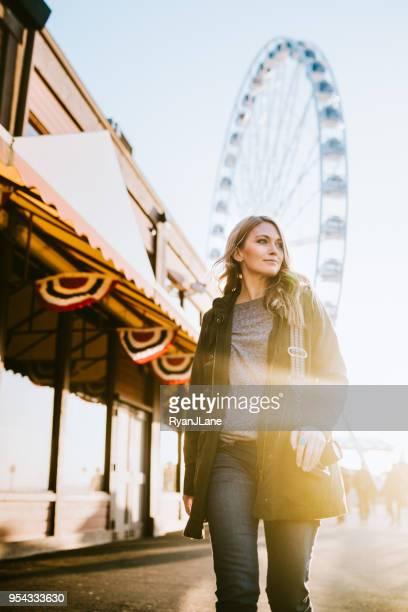 female film photographer explores seattle waterfront - seattle imagens e fotografias de stock