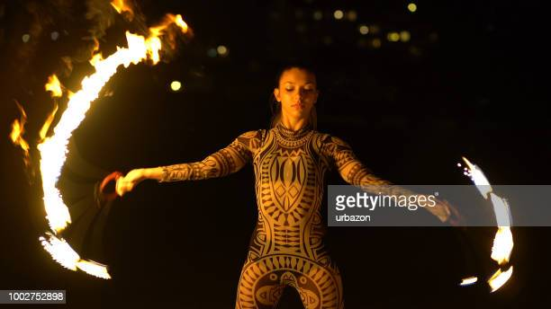 female fire acrobat at night - circus stock photos and pictures