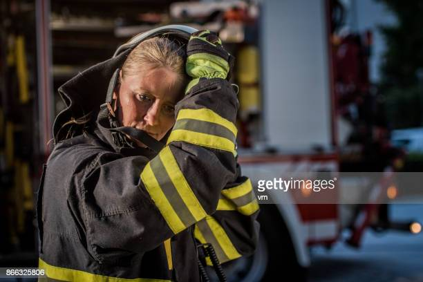 female firefigher - fire protection suit stock pictures, royalty-free photos & images