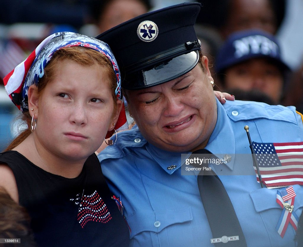 A female firefighter cries during the 'Prayer for America' service held September 23, 2001 at Yankee Stadium in New York City. The two hour memorial service was held in memory of those who died in the terrorist attack on the World Trade Center, which killed some 3,000 people.