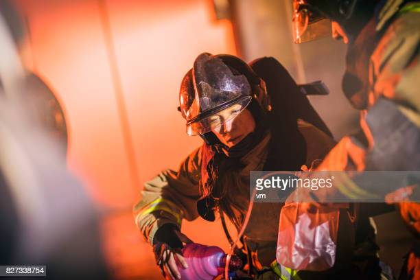 Female firefighter helping injured