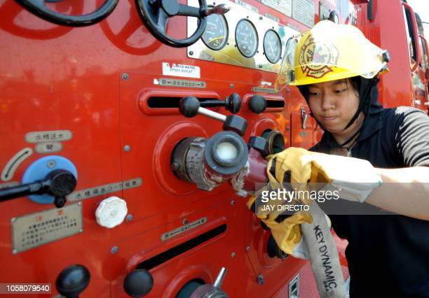 A female firefighter joins a firefighting competition in Manila on March 7 2009 The competition was part of activities leading up to fire prevention...