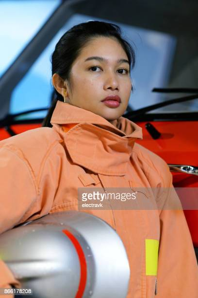 female firefighter - fire protection suit stock photos and pictures