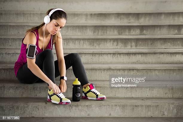 Female fitness athlete tying shoe lace
