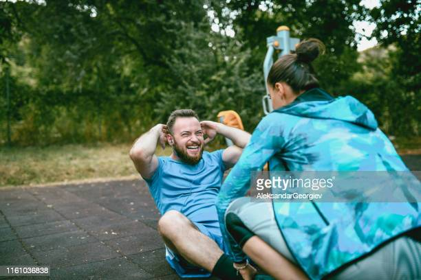 female fitness instructor working out with client - sports training stock pictures, royalty-free photos & images
