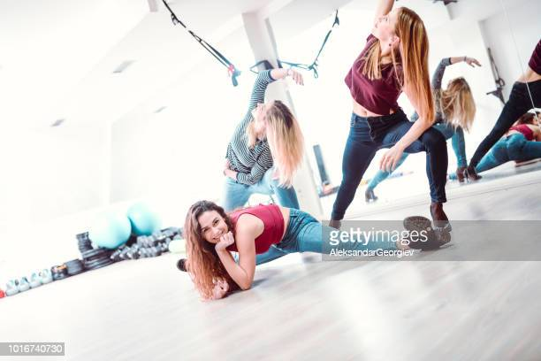 Female Fitness Team Working Out Together In Gym