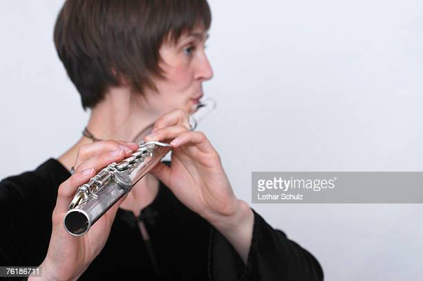 a female flautist - classical musician stock pictures, royalty-free photos & images