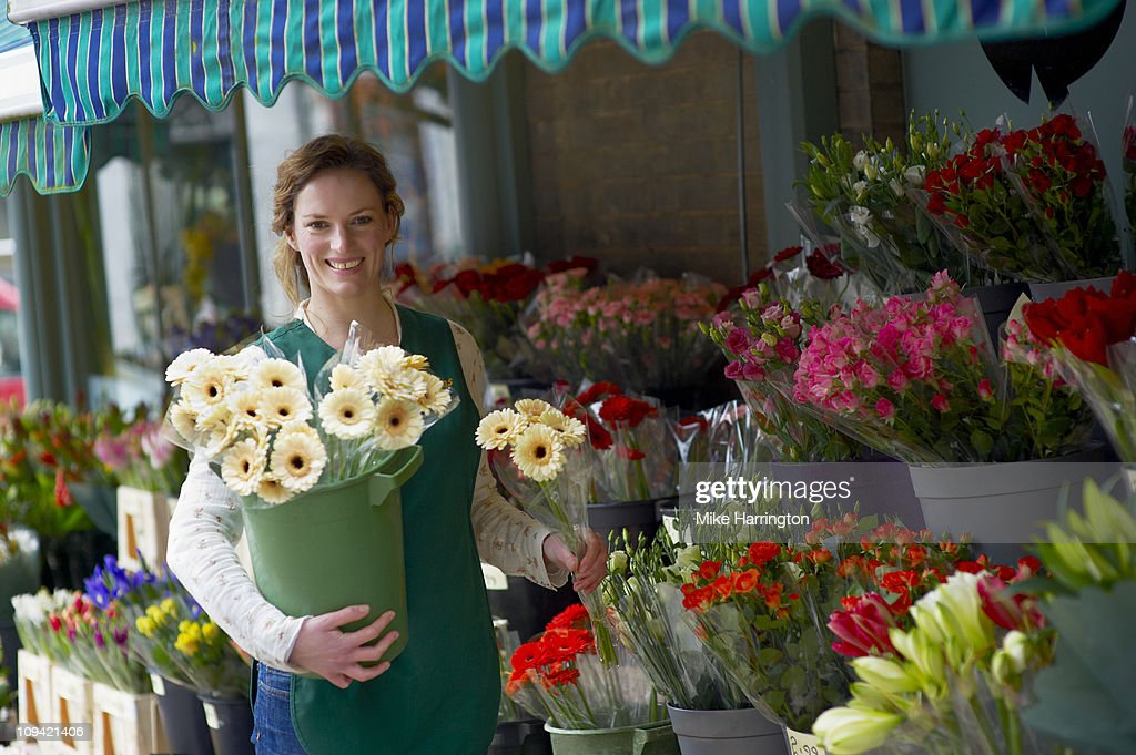 Female Florist Holding a Selection of Flowers : Stock Photo