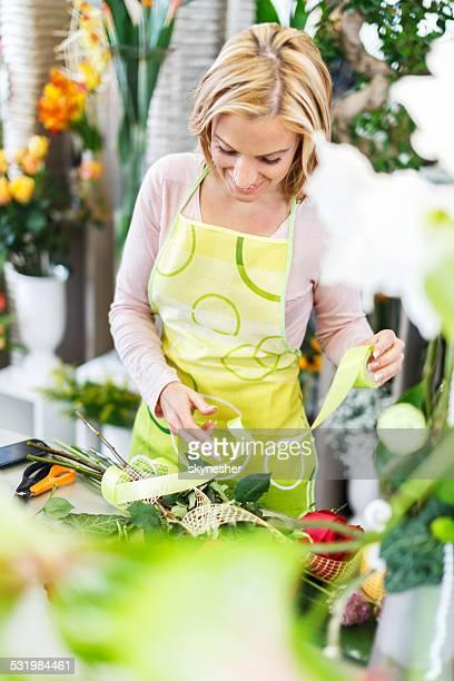 Female florist in a flower shop.