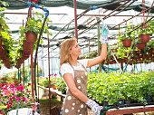 female florist temperature control at nursery