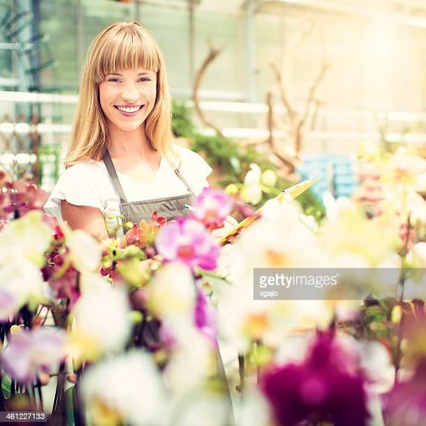 Female Florist Working At Garden Center.