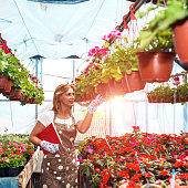 female florist working at greenhouse