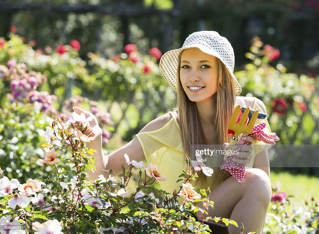 Female florist working in garden : Stock Photo