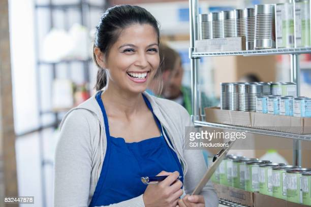 Female food bank manager works in store room