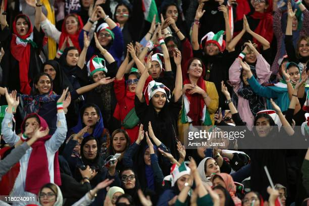 Female football fans show their support during of the FIFA World Cup Qualifier match between Iran and Cambodia at Azadi Stadium on October 10, 2019...