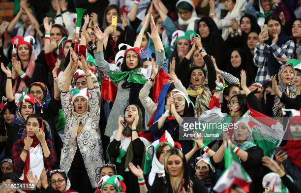 Female football fans show their support during of the FIFA World Cup Qualifier match between Iran and Cambodia at Azadi Stadium on October 10 2019 in...