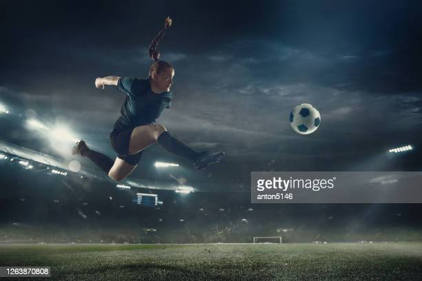 female football or soccer player at stadium - motion, action, activity concept - the championship football league stock pictures, royalty-free photos & images