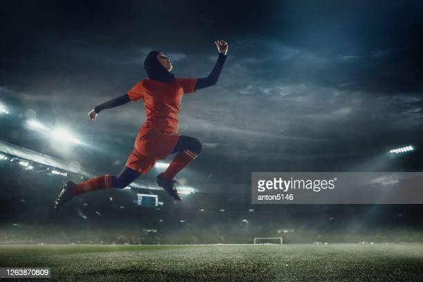 female football or soccer player at stadium - motion, action, activity concept - football stock pictures, royalty-free photos & images