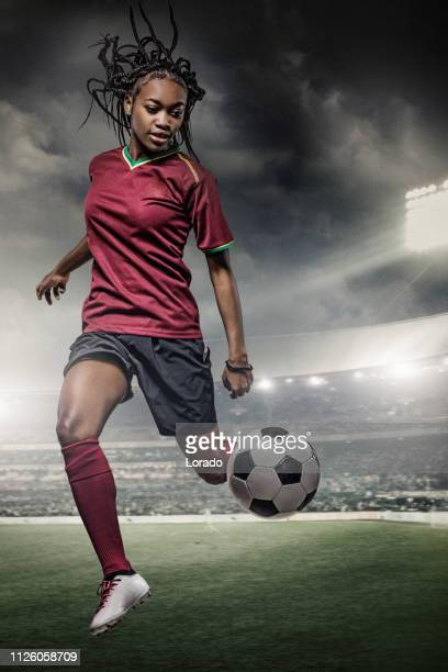 female football player in action in a stadium - international team soccer stock pictures, royalty-free photos & images