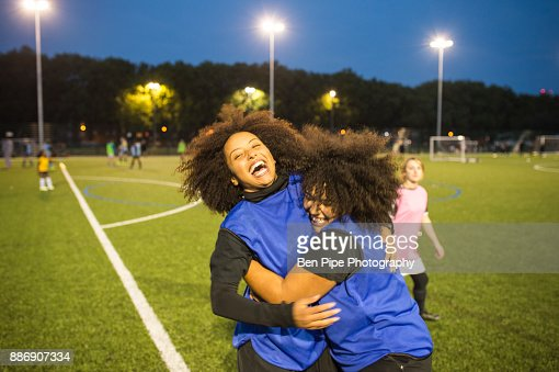 Female football players jubilant, Hackney, East London, UK
