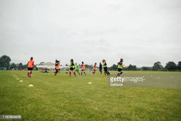 female football team practice - football training stock pictures, royalty-free photos & images