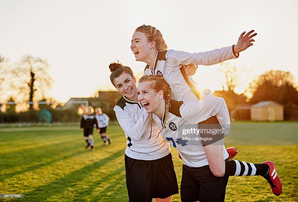 Female footballers celebrating goal : Stock Photo