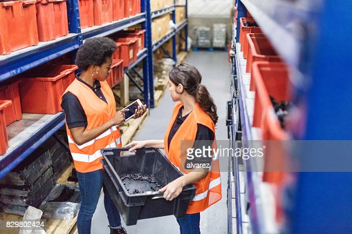 Female foremen and coworker working in warehouse