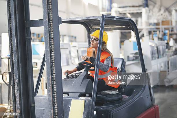female forklift operater - forklift stock pictures, royalty-free photos & images