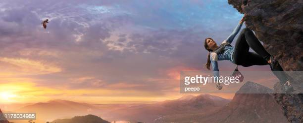 female free climber high on steep rock face at dawn - climbing stock pictures, royalty-free photos & images