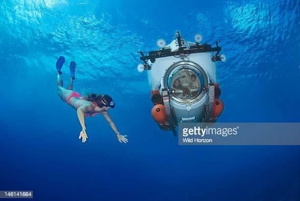 Female freediver looking at Nuytco underwater minsub Depth was approximately 40 feet Seaquarium Curacao Netherlands Antilles Digital Photo
