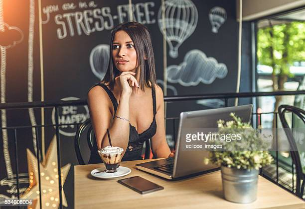female freelancer sit at the table with net-book