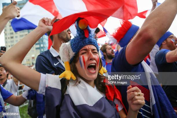A female french football fan seen celebrating French football fans celebrate their national football team victory over uruguay during the...